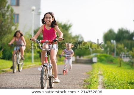 幸せ · 女の子 · ライディング · スクーター · 孤立した · 白 - ストックフォト © stockyimages