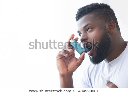 Sick person using respiratory spray Stock photo © barabasa