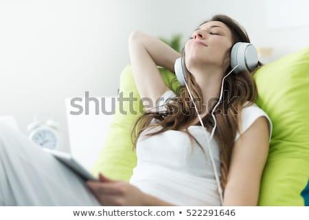 Nő megnyugtató zenét hallgat ágy lezser kék Stock fotó © AndreyPopov