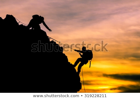 Businessman climbing on the rocks Stock photo © ratch0013