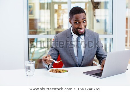 Man eating his tie Stock photo © smithore