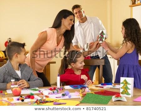 hispanic family making christmas cards stock photo © monkey_business