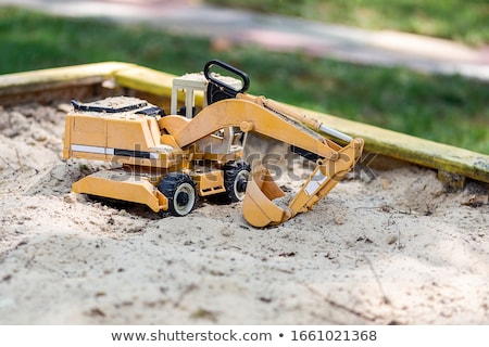 Boy playing with toy truck outdoor stock photo © d13