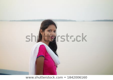 portriat of the charming brunette looking at the lake stock photo © konradbak