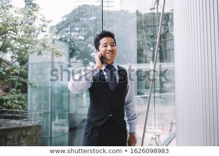 Happy smiling businessman looking away Stock photo © czaroot