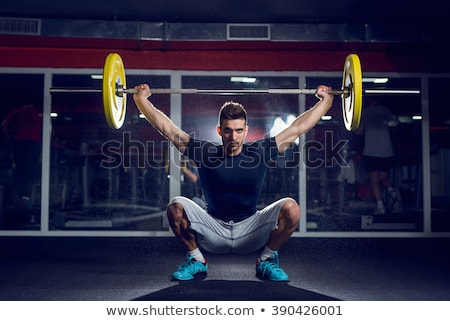 Attractive man weightlifting Stock photo © stokkete