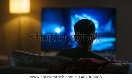 man watching movie stock photo © andreypopov