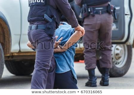 Nő rendőrség bilincs fehér modell biztonság Stock fotó © Elnur