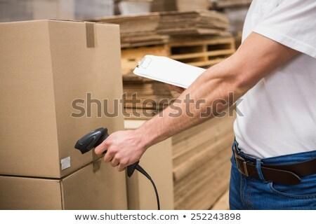 Középső rész munkás szkenner raktár közelkép férfi Stock fotó © wavebreak_media