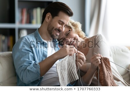 laughing senior lady sitting knitting stock photo © ozgur