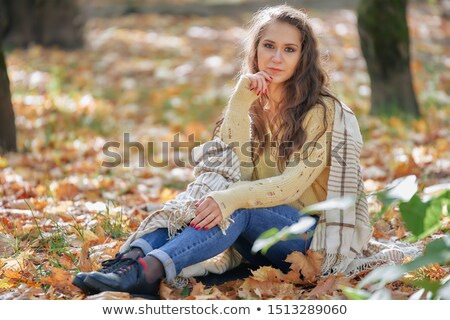 Gorgeous young woman sitting daydreaming Stock photo © dash