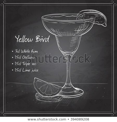 Yellow Bird is a cocktail on black board Stock photo © netkov1