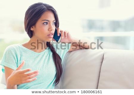 Ernstig brunette meisje telefoongesprek mooie Stockfoto © deandrobot