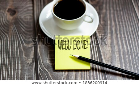well done text on notepad and pencil stock photo © fuzzbones0