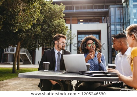 fiatal · igazgató · üzleti · csapat · kint · asztal · tervez - stock fotó © pixinoo