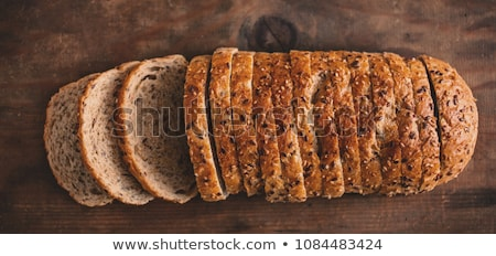 Different bread and bread slices. Food background and wooden rus Stock photo © Yatsenko