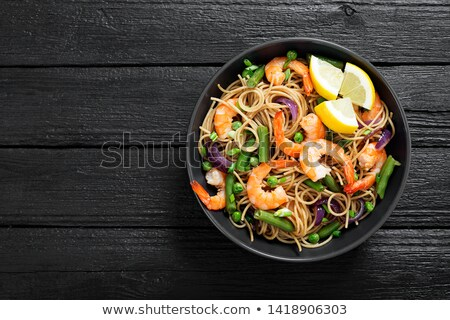 Cooked shrimps and vegetable on plate Stock photo © bluering