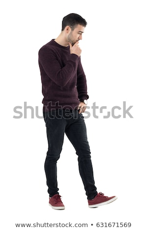 side view of a casual young man looking down stock photo © feedough