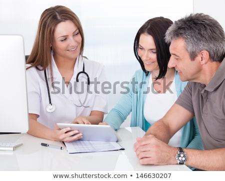 idős · nő · orvos · táblagép · kórház · gyógyszer - stock fotó © dolgachov