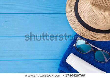 Close up of sunhat and sunglasses on sand Stock photo © wavebreak_media