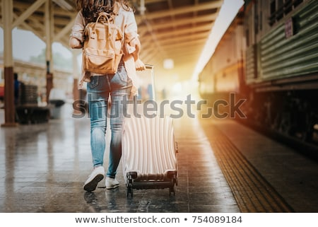 Summer Vacation Concept Girl Travels with Luggage. Stock photo © robuart