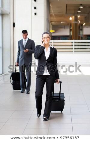 Erkek yürütme bagaj konuşma cep telefonu beyaz Stok fotoğraf © wavebreak_media