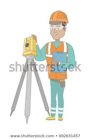 Hispanic surveyor builder working with theodolite. Stock photo © RAStudio