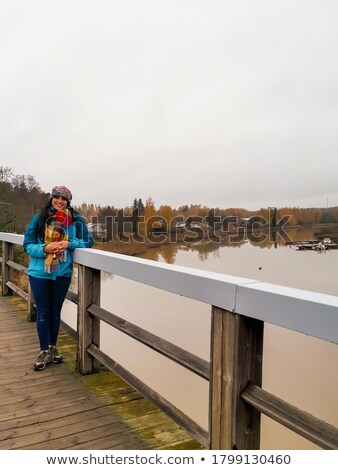 Woman relaxing on harbor next to boat Stock photo © IS2