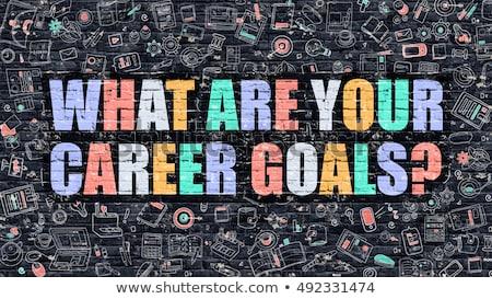 Achieve Your Career Goals on Dark Brick Wall. Stock photo © tashatuvango
