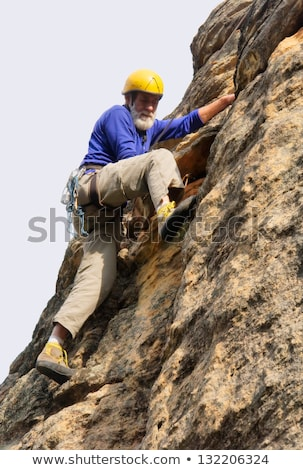 senior man with climbing rope at rock stock photo © is2