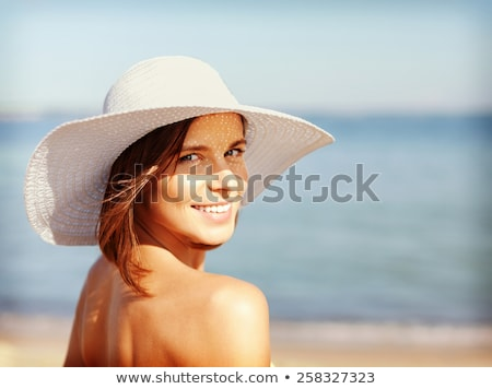 smiling young woman in sun hat on summer beach Stock photo © dolgachov