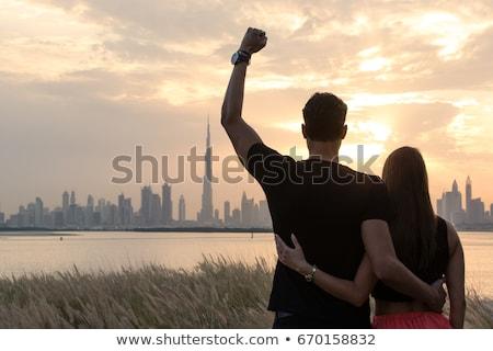 カップル 見える 美しい 日没 女性 ストックフォト © majdansky