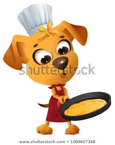 Fun yellow dog cook to make pancake in frying pan Stock photo © orensila