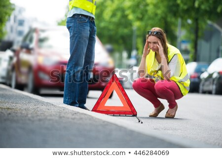Woman standing by the broken car and warning triangle sign Stock photo © Nobilior