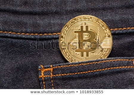Bitcoin Physical Coin In Denim Pocket Stock photo © ivelin