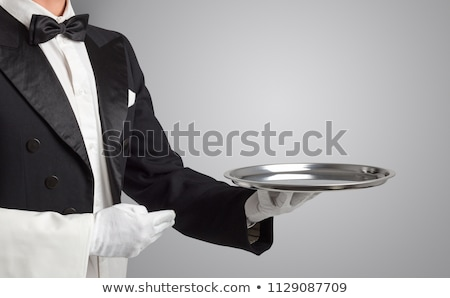 Servant white glove holds stainless steel tray stock photo © DenisMArt