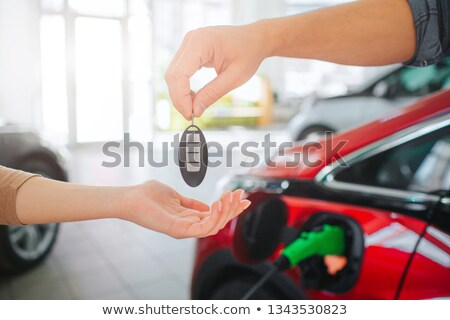 Couple close, electric car in background Stock photo © IS2