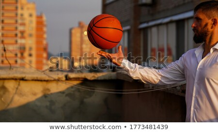 Man holding basketball on rooftop Stock photo © IS2