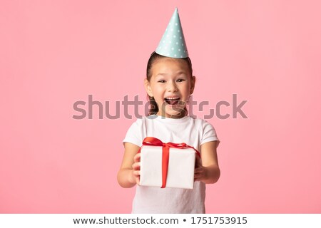 little girl wearing party hat stock photo © is2