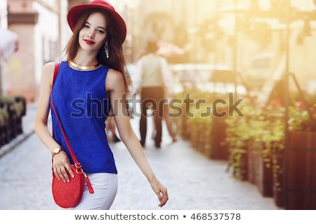 Portret jonge vrouw fedora witte achtergrond Stockfoto © IS2