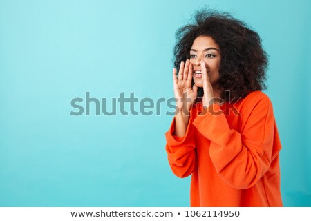 Cute american woman in colorful shirt with shaggy hair shouting  Stock photo © deandrobot