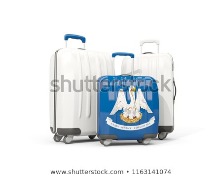 Luggage with flag of louisiana. Three bags with united states lo Stock photo © MikhailMishchenko