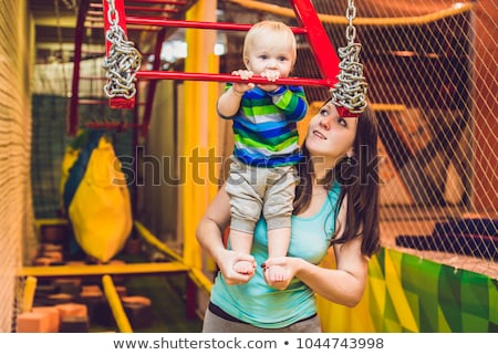 mother and son passes the obstacle course in the sports club stock photo © galitskaya