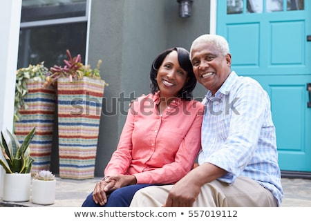happy senior couple in love relaxing together in the garden in summer stock photo © kzenon