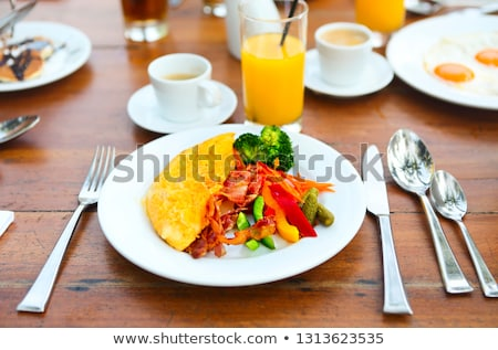 Omelet with pepper, cucumber, bakon and salad on the table  Stock photo © dashapetrenko