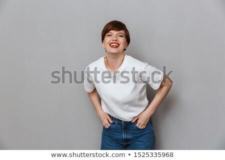 Lovely woman with charming smile. Isolated on gray background Stock photo © studiolucky
