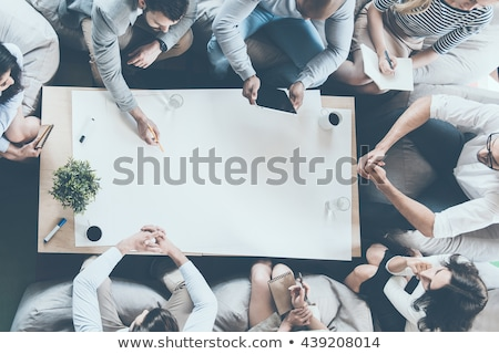Business person sitting at desk with direction concept Stock photo © ra2studio