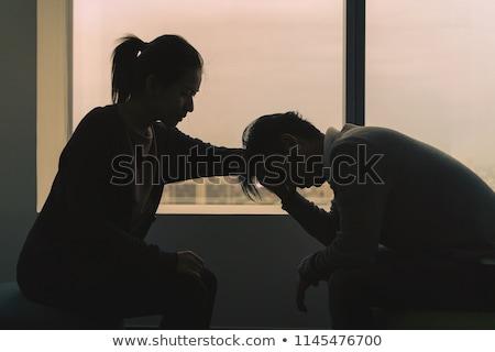 Fiatal pszichológus beszél lehangolt pár fiatal pér Stock fotó © AndreyPopov