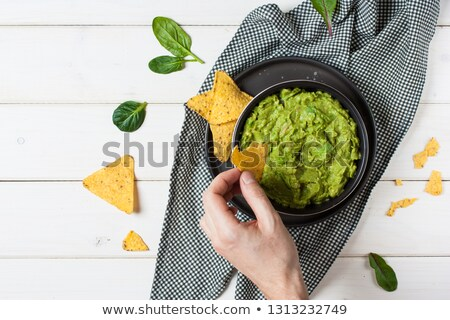 Avocado and tortilla chips  with vegetables Stock photo © mythja