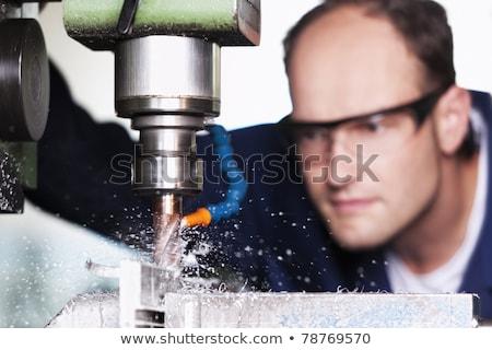 Macro of laborer at milling machine. Stock photo © lichtmeister